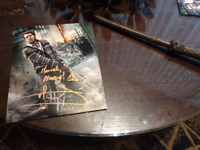 [picture of a wand next to a signed copy of Neville Longbottom from Harry Potter]